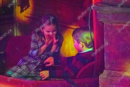 Britain's Princess Charlotte and Prince George attend a special pantomime performance at London's Palladium Theatre, hosted by The National Lottery, to thank key workers and their families for their efforts throughout the COVID-19 pandemic