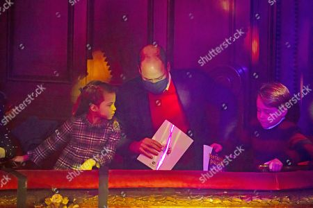 The Duke of Cambridge with Princess Charlotte and Prince George attend a special pantomime performance at London's Palladium Theatre, hosted by The National Lottery, to thank key workers and their families for their efforts throughout the pandemic.