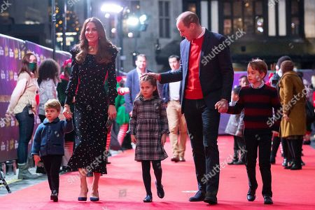 Prince William and Catherine Duchess of Cambridge and their children, Prince Louis, Princess Charlotte and Prince George attend a special pantomime performance at London's Palladium Theatre, hosted by The National Lottery, to thank key workers and their families for their efforts throughout the pandemic.