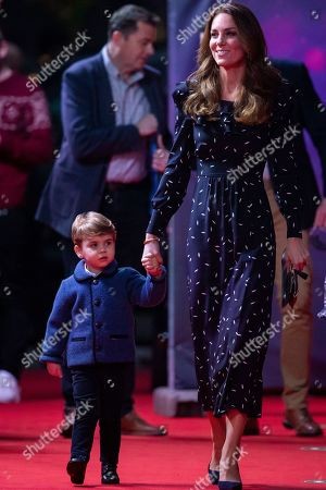 Catherine Duchess of Cambridge with Prince Louis attend a special pantomime performance at London's Palladium Theatre, hosted by The National Lottery, to thank key workers and their families for their efforts throughout the pandemic.