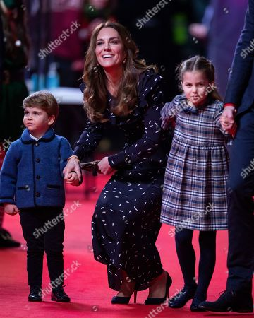 Prince Louis, Catherine Duchess of Cambridge and Princess Charlotte attend a special pantomime performance at London's Palladium Theatre, hosted by The National Lottery, to thank key workers and their families for their efforts throughout the pandemic.