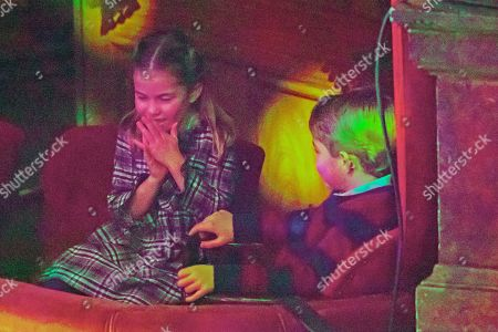 Princess Charlotte and Prince George attend a special pantomime performance at London's Palladium Theatre, hosted by The National Lottery, to thank key workers and their families for their efforts throughout the pandemic.