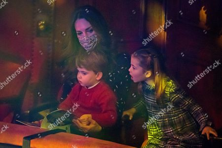 Catherine Duchess of Cambridge with Prince Louis and Princess Charlotte attend a special pantomime performance at London's Palladium Theatre, hosted by The National Lottery, to thank key workers and their families for their efforts throughout the pandemic.
