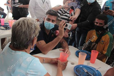 Venezuelan opposition leader Leopoldo Lopez speaks with citizens of his country at a migrant shelter in the sector of La Parada, border point with Venezuela near the city of Cucuta, Norte de Santander, Colombia, 11 December 2020. The Venezuelan politician will be in Colombia for several days, and after meeting a day earlier with President Ivan Duque, he visits the main place of emigration of his fellow citizens, bordering the state of Tachira.