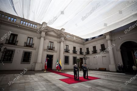 The President of Chile, Sebastian Pinera (L), takes part together with his Colombian counterpart, Ivan Duque (R), in a press conference on the occasion of the XV Summit of the Pacific Alliance, at the Palacio de La Moneda in Santiago, Chile, 11 December 2020. Pinera and Duque lead in Santiago the XV Summit of the Pacific Alliance, a bloc also made up of Mexico and Peru, whose leaders will participate virtually due to the coronavirus pandemic. Within the framework of this summit, the bloc will sign a declaration on gender equality, another on regional digital market and digital transformation, and the Santiago Declaration.