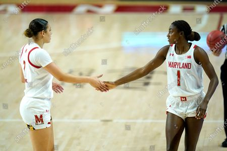 Stock Image of Maryland forward Mimi Collins, left, and guard Diamond Miller react during the first half of an NCAA college basketball game against Towson, in College Park, Md