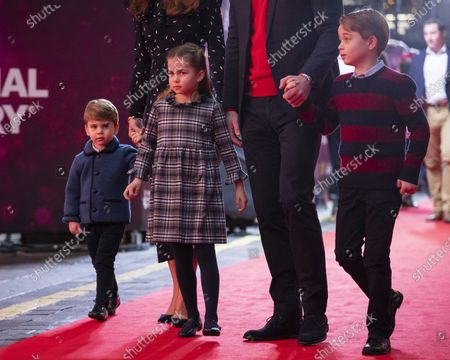 Stock Photo of Britain's Prince William and Kate, The Duke and Duchess of Cambridge and their children, Prince Louis, left, Princess Charlotte and Prince George arrive for a special pantomime performance at London's Palladium Theatre, hosted by The National Lottery, to thank key workers and their families for their efforts throughout the COVID-19 pandemic