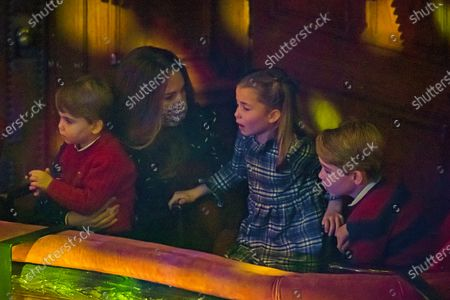 Stock Image of Britain's Kate, Duchess of Cambridge, Prince Louis and Princess Charlotte and Prince George attend a special pantomime performance at London's Palladium Theatre, hosted by The National Lottery, to thank key workers and their families for their efforts throughout the COVID-19 pandemic