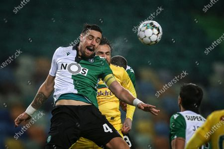Sporting of Lisbon player Coates (L) duels with Pacos de Ferreira player Marco Baixinho during their Portugal Cup 4th round P soccer match held at Avalade stadium, in Lisbon, 11 December 2020.