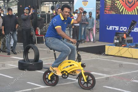 Tennis player Leander Paes gestures during a promotional event for electric cycle Motovolt, at Metro Cash & Carry on December 11, 2020 in Kolkata, India.