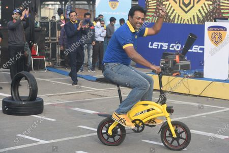 Tennis player Leander Paes riding an electric bicycle during a promotional event for Motovolt at Metro Cash & Carry on December 11, 2020 in Kolkata, India.
