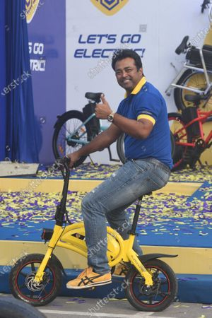 Stock Image of Tennis player Leander Paes riding an electric bicycle during a promotional event for Motovolt at Metro Cash & Carry on December 11, 2020 in Kolkata, India.