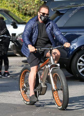 Arnold Schwarzenegger seen on a bike ride in Brentwood