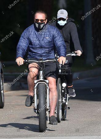 Arnold Schwarzenegger and Christina Schwarzenegger seen on a bike ride in Brentwood