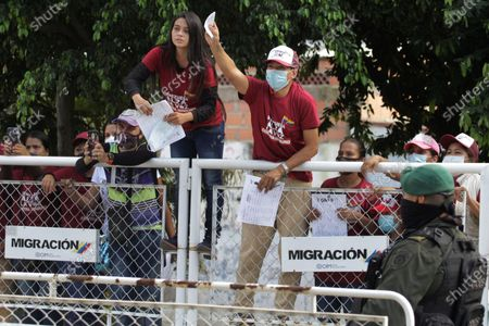 Venezuelan citizens greet Venezuelan opposition leader Leopoldo Lopez (out of frame) in the La Parada sector, the border point with Venezuela, near the city of Cucuta, Colombia, 11 December 2020. Lopez, who arrived in Colombia from Spain on 09 December and held a meeting with President Ivan Duque, visited the main emigration passage of his compatriots in Cucuta, on the border with the Venezuelan state of Tachira, from where he insisted on the request to Venezuelans to participate in the popular consultation and reiterated its call for protests on 12 December.
