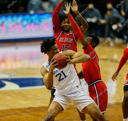 , 2020, Newark, New Jersey, USA: Seton Hall Pirates center Ike Obiagu (21) get pressure from St. John's Red Storm guards Greg Williams Jr. (4) and Vince Cole (15) in the first half at the Prudential Center in Newark, New Jersey. Seton Hall defeated St Johns 77-68