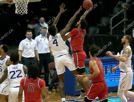 , 2020, Newark, New Jersey, USA: Seton Hall Pirates forward Tyrese Samuel (4) defends St. John's Red Storm guard Julian Champagnie (2) at the basket in the first half at the Prudential Center in Newark, New Jersey. Seton Hall defeated St Johns 77-68