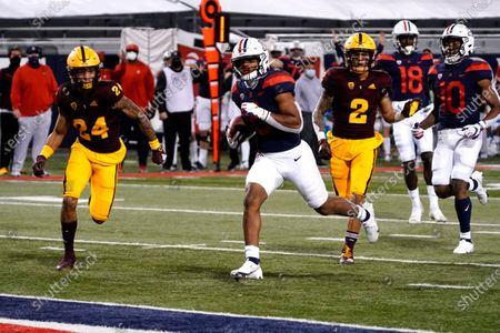 Arizona running back Michael Wiley (6) scores a touchdown against Arizona State during the first half during an NCAA college football game, in Tucson, Ariz