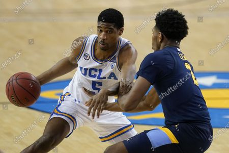 Guard Chris Smith, left, is defended by Marquette forward Justin Lewis during the second half of an NCAA college basketball game, in Los Angeles