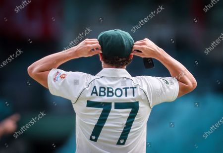 Australia's Sean Abbott adjusts his cap during Day 2 of the tour match between Australia A and India at the SCG in Sydney, Australia, 12 December 2020.