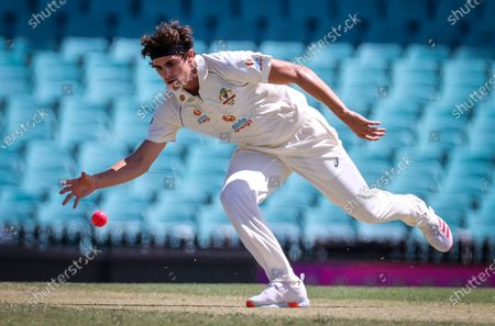 Australia's Sean Abbott stretches to field the ball during Day 2 of the tour match between Australia A and India at the SCG in Sydney, Australia, 12 December 2020.