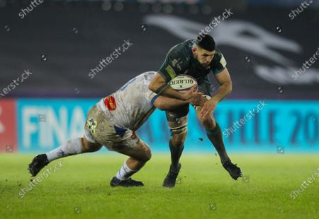 Rhys Davies of Ospreys is tackled by Daniel Kotze of Castres; Liberty Stadium, Swansea, Glamorgan, Wales; European Rugby Challenge Cup, Ospreys versus Castres.