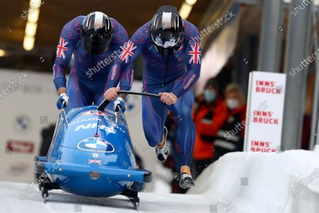 Stock Photo of Brad Hall and Nick Gleeson of Britain start the two men's Bobsled World Cup race in Igls, near Innsbruck, Austria