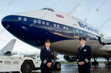 Captains Alister Bridger (L) and Richard Allen-Willians (R) infant of British Airways' last remaining Boeing 747 registration G-BYGC at eCube Solutions at Bro Tathan business park