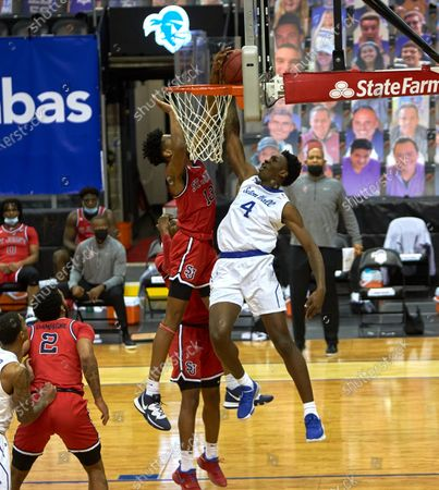 Stock Image of , 2020, Newark, New Jersey, USA: St. John's Red Storm forward Isaih Moore (13) blocks Seton Hall Pirates forward Tyrese Samuel (4) shot in the first half at the Prudential Center in Newark, New Jersey. Seton Hall defeated St Johns 77-68