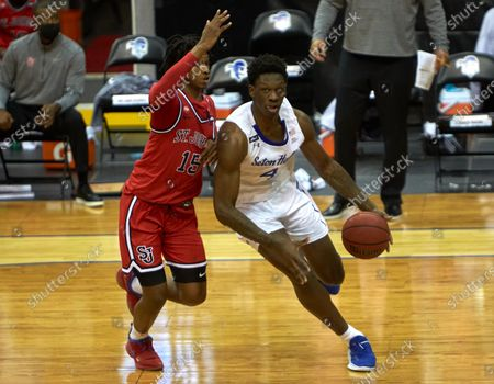 , 2020, Newark, New Jersey, USA: Seton Hall Pirates forward Tyrese Samuel (4) penetrates toward the basket as St. John's Red Storm guard Vince Cole (15) defends in the first half at the Prudential Center in Newark, New Jersey. Seton Hall defeated St Johns 77-68
