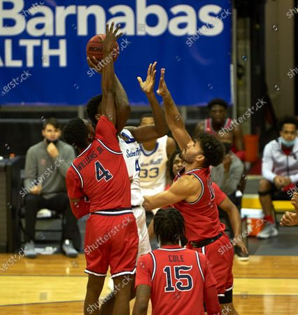Stock Photo of , 2020, Newark, New Jersey, USA: Seton Hall Pirates forward Tyrese Samuel (4) shoots in a crowd of Red Storm defenders in the first half at the Prudential Center in Newark, New Jersey. Seton Hall defeated St Johns 77-68