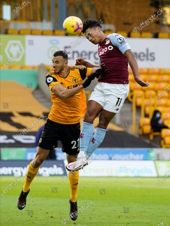 Aston Villa's Ahmed Elmohamady, right, and Wolverhampton Wanderers' Romain Saiss challenge for the ball during the English Premier League soccer match between Wolverhampton and Aston Villa at Molineux Stadium in Wolverhampton, England
