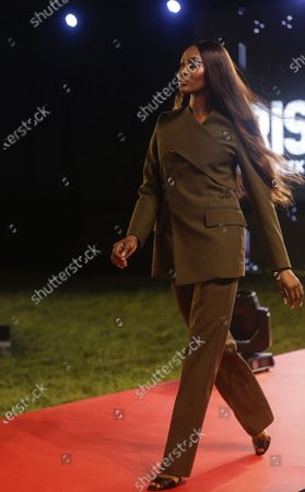 British model Naomi Campbell displays an outfit by designer MMUSO MAXWELL during the ARISE Fashion Week event in Lagos, Nigeria early