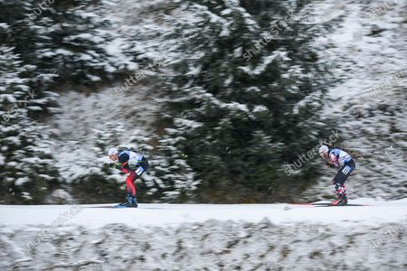 Vetle Sjaastad Christiansen of Norway (L) and Simon Eder of Austria (R) in action during the Men's 12,5km Pursuit race at the IBU Biathlon World Cup in Hochfilzen, Austria, 12 December 2020.