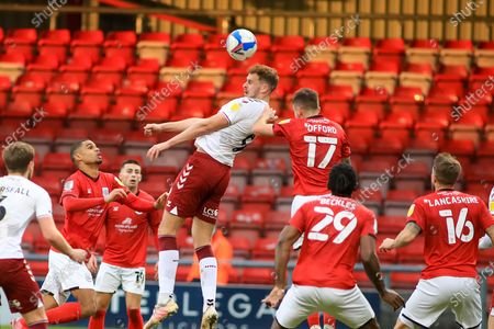 Northampton Town forward Harry Smith (9) goes up for a header with Crewe Alexandra defender Luke Offord (17) during the EFL Sky Bet League 1 match between Crewe Alexandra and Northampton Town at Alexandra Stadium, Crewe
