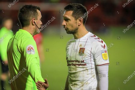 Northampton Town defender Joe Martin (3) argues with the linesman after being sent off during the EFL Sky Bet League 1 match between Crewe Alexandra and Northampton Town at Alexandra Stadium, Crewe