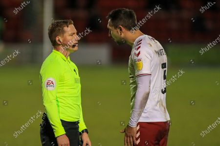 Northampton Town defender Joe Martin (3) discussing his sending off with the referee during the EFL Sky Bet League 1 match between Crewe Alexandra and Northampton Town at Alexandra Stadium, Crewe