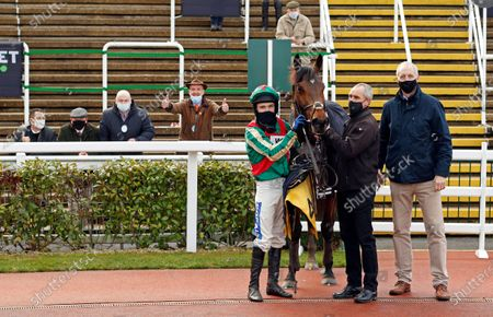 Stock Picture of ADAGIO (Tom Scudamore) with trainer David Pipe and owners after The JCB Triumph Trial Juvenile Hurdle Cheltenham