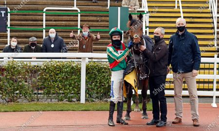ADAGIO (Tom Scudamore) with trainer David Pipe and owners after The JCB Triumph Trial Juvenile Hurdle Cheltenham