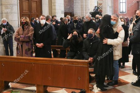 Former Italian soccer player Marco Tardelli (2L) and his partner, Italian journalist Myrta Merlino (L), during the funeral of Paolo Rossi  at the Santa Maria Annunciata Cathedral in Vicenza, northeastern Italy, 12  December 2020. Rossi, former Italy's soccer legend, died on 09 december 2020 at the age of 64.