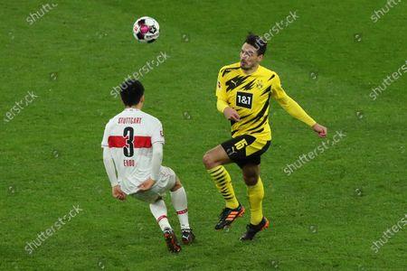 Dortmund's Mats Hummels (R) in action against Stuttgart's Wataru Endo during the German Bundesliga soccer match between Borussia Dortmund and VfB Stuttgart in Dortmund, Germany, 12 December 2020.