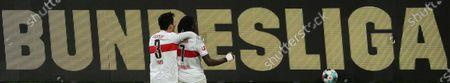 Stuttgart's Tanguy Coulibaly (R) celebrates with Stuttgart's Wataru Endo after scoring his team's fourth goal during the German Bundesliga soccer match between Borussia Dortmund and VfB Stuttgart in Dortmund, Germany, 12 December 2020.