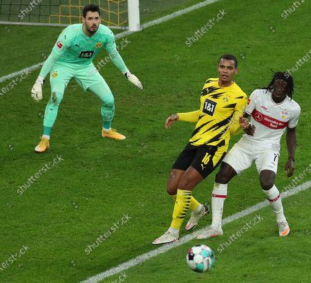 Dortmund's goalkeeper Roman Buerki (L) and Dortmund's Manuel Akanji (C) in action against Stuttgart's Tanguy Coulibaly (R) during the German Bundesliga soccer match between Borussia Dortmund and VfB Stuttgart in Dortmund, Germany, 12 December 2020.