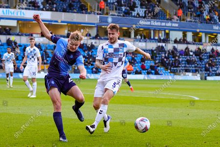 Alex Samuel (25) of Wycombe Wanderers passes the ball during the EFL Sky Bet Championship match between Wycombe Wanderers and Coventry City at Adams Park, High Wycombe
