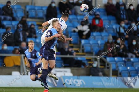 Dominic Hyam (15) of Coventry City and Alex Samuel (25) of Wycombe Wanderers clash in the air during the EFL Sky Bet Championship match between Wycombe Wanderers and Coventry City at Adams Park, High Wycombe