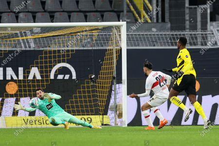 Nicolas Gonzalez (C) of VfB Stuttgart scores his team's fifth goal past Roman Buerki (L) of Borussia Dortmund during the German Bundesliga soccer match between Borussia Dortmund and VfB Stuttgart at Signal Iduna Park in Dortmund, Germany, 12 December 2020.