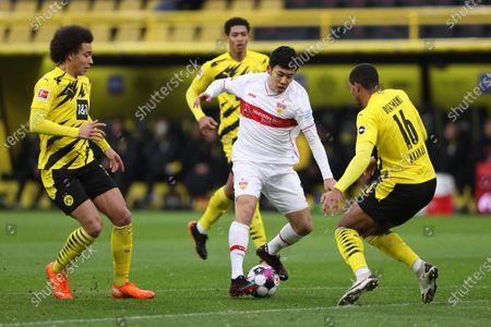 Wataru Endo (C) of VfB Stuttgart is challenged by Axel Witsel (L) and Manuel Akanji (R) of Borussia Dortmund during the German Bundesliga soccer match between Borussia Dortmund and VfB Stuttgart at Signal Iduna Park in Dortmund, Germany, 12 December 2020.
