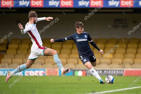 Tom Clifford, Southend United clears under pressure from John McAfee, Scunthorpe United during Southend United vs Scunthorpe United, Sky Bet EFL League 2 Football at Roots Hall on 12th December 2020
