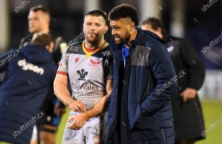 Rob Evans of Scarlets and Taulupe Faletau of Bath at the end of the game.