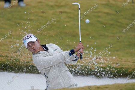 Stock Picture of Jenny Shin, of South Korea, hits out of the bunker on the first hole during the third round of the U.S. Women's Open golf tournament, in Houston